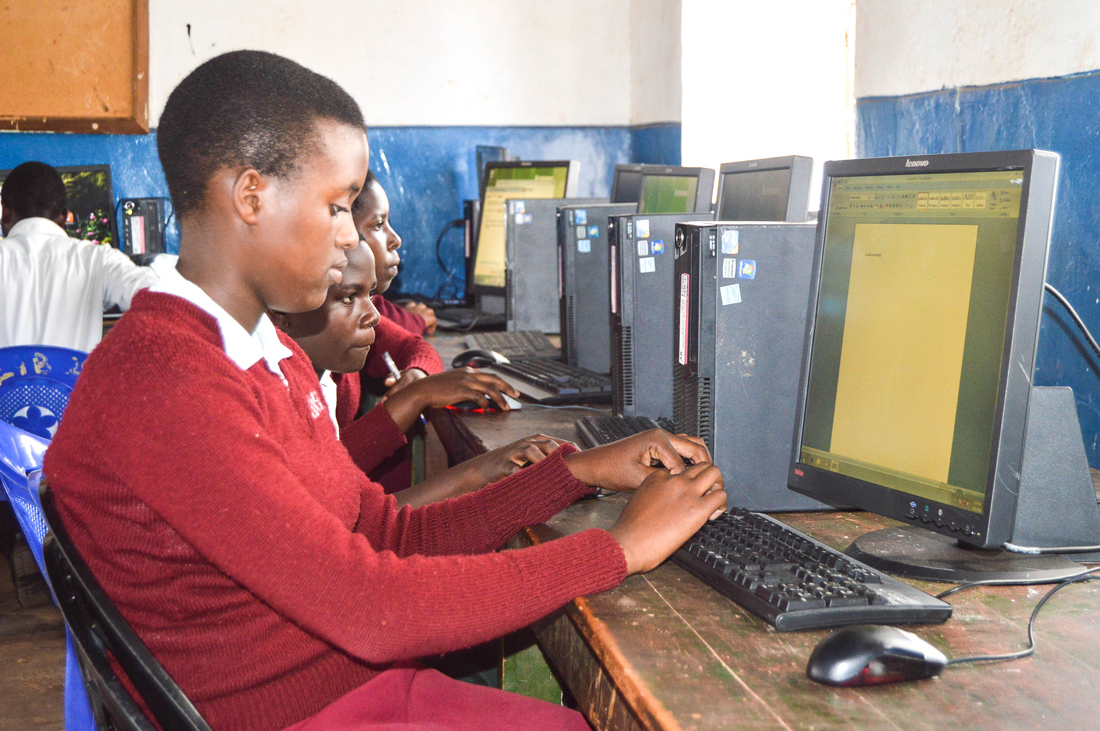 Lunjika Adventist Secondary School, Malawi. Learning to use computers at school for the first time.