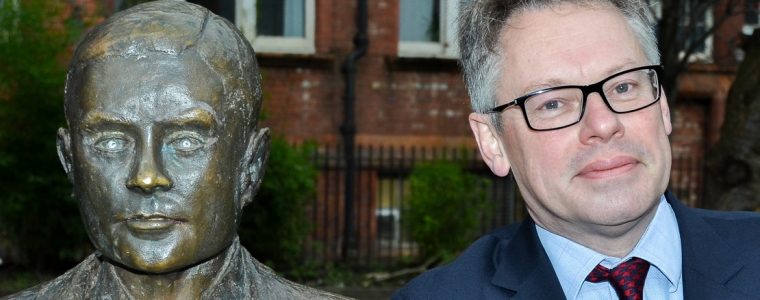 Dermot Turing with the statue of his uncle, Alan Turing, in Manchester