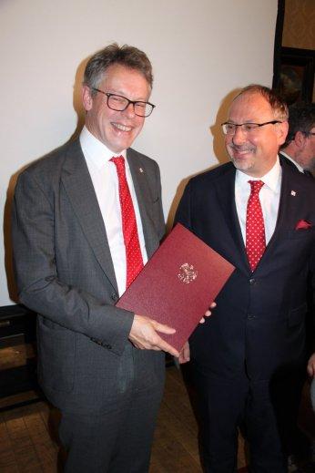 Polish Ambassodor Dr Arkady Rzegocki presents Dermot Turing with a letter from the President of the Republic of Poland Andrzej Duda