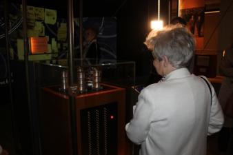 Mrs Sylwestrzak views a replica bomba in Hut 11A, Bletchley Park