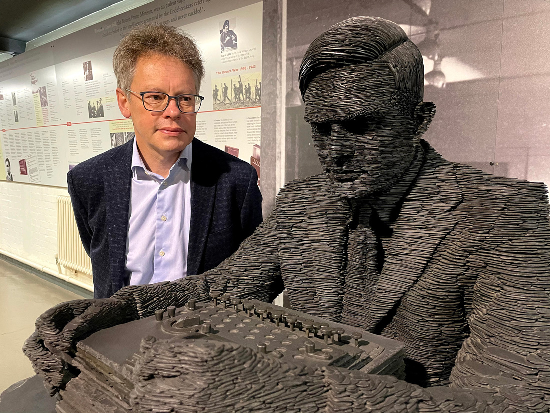 Dermot Turing with statue of Alan Turing at Bletchley Park. Photo by K T Bruce