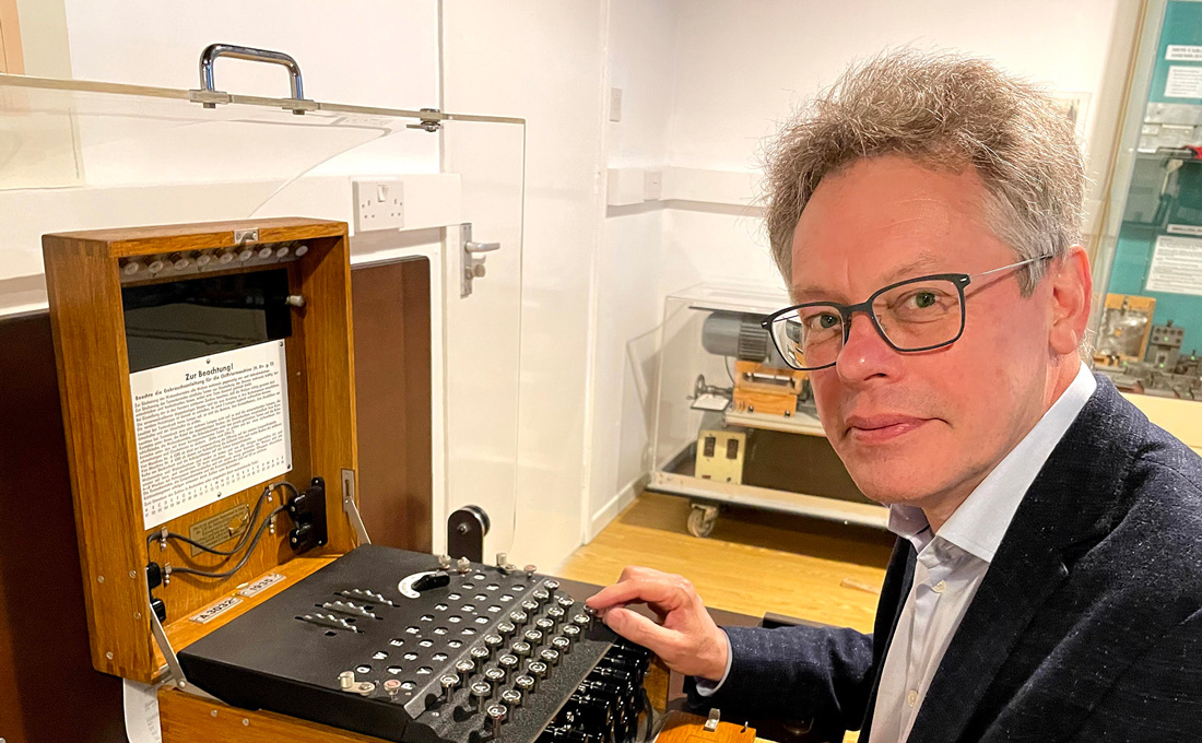 Dermot Turing with an Enigma machine. Photo by KT Bruce